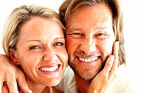Closeup of a happy loving couple smiling together against white background