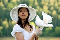 young woman with white dove