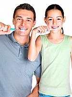 Portrait of a young man brushing with his daugther against white background