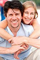Closeup portrait of smiling mature couple relaxing outdoors