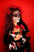 Women With Roses for Dia De Los Muertos