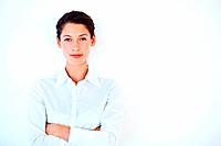 Portrait of confident young business woman smiling over white background