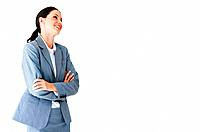 Portrait of happy young business woman with hands folded at office
