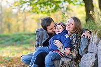 Young family enjoying beautiful autumn day