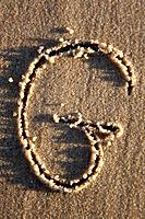 Letter written on wet sand