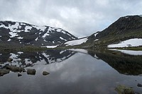 cloud_covered mountains at a mountain lake, Norway, Jotunheimen National Park