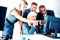 Portrait of tensed multi ethnic business team looking at computer while discussing in office