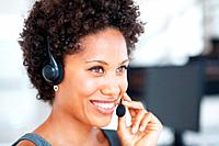 Closeup of beautiful female customer service representative smiling at work