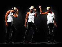 Full length of young man performing various dance moves on black background