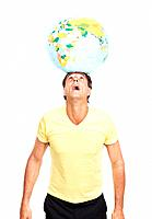 Portrait of a casual mature man balancing a terrestrial globe on his head against white background