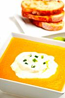 pumpkin soup and baguette isolated on white