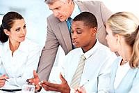 African american businessman in meeting with colleagues discussing working ideas