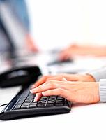 Cropped image of female executive typing on the computer keyboard