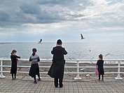 Orthodox hasidic jewish families on summer holiday in Aberystwyth Ceredigion Wales UK