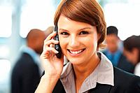 Closeup of young businesswoman on phone call indoors