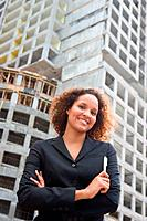 Businesswoman in Front of Construction Site