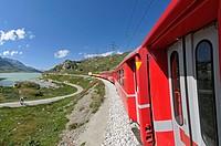 Train ride with Rhätische Bahn on the Bernina line from Ospizio Bernina to Poschiavo passing the Lago Bianco  Switzerland, Western Europe, Graubünden,...