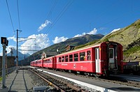 Train of Rhätische Bahn at Ospizio Bernina railway station on the Berninapass  Switzerland, Western Europe, Graubünden, Bernina, UNESCO World Heritage...