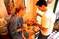 Young Couple Using Juice Extractor