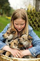 Girl Hugging Puppies