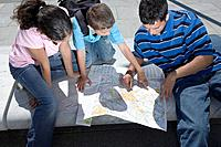 Father and Children Looking at Map