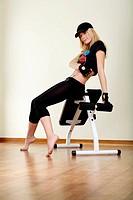girl sitting on fitness machine