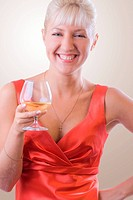 Blond woman with a glass of wine. 1