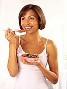 Woman Eating Fresh Fruit Salad