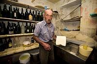 Guglielmo Locatelli in the laboratory of his dairy pasture, Taleggio valley, Lombardy, Italy