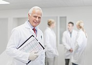 Scientist with notes in pathology lab