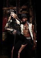 Trendy couple in warehouse