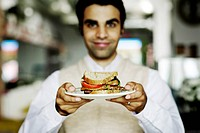 Waiter Holding Sandwich