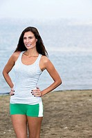 Beauty portrait of mid adult woman outdoors in exercise clothing