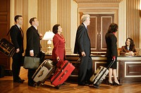 Businesspeople Arriving at Hotel
