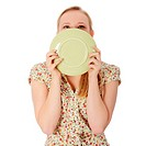 Woman licking plate