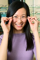 Woman Trying Glasses at Optometrist´s Office