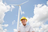 Portrait of man in hard hat on wind farm, near Shelburne, Ontario