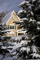 Artist´s Choice: Partial view of cottage_style home in winter, Laval, Quebec