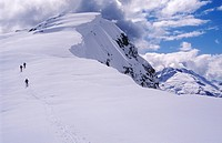 Skiers approach Cloudburst Mountain, north of Squamish, British Columbia, Canada.