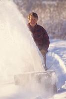 Man using snowblower, Smithers, British Columbia, Canada.