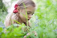 Girl picking wildflowers