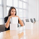 Businesswoman with sculptures at conference table