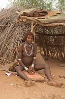 Pregnant Hamar woman with necklaces of Cowry shells, Hamar Tribe, Omo river valley, Southern Ethiopia