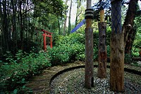 A torii gate and sculpture at the Hruska Botanical Gardens in Gardone. The gardens were the work of naturalist Arturo Hruska and contain more than 2,0...