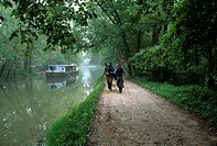 Mule skinners lead mules pulling the C&O Canal Clipper barge along the Chesapeake & Ohio Canal in Maryland.
