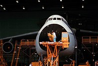 Workers at Lockheed prepare a C_5A for its first flight. Atlanta, June 1968.