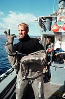 Diver Putting on Anti_Shark Suit