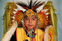 Tyson Draper, 10, wears elaborate Native American dress at the Navajo Community College Pow Wow in Tsaile, Arizona.