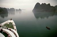 A sampan on Halong Bay in Vietnam, seen from the cruise ship Royal Viking Sun.