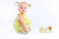 Cute little girl in a yellow dress with really live chickens.